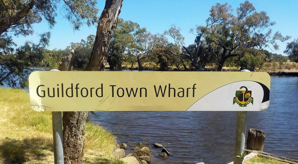 Guildford Town Wharf sign by the river near the bridge